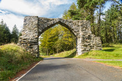 The Jubilee Arch, old graceful stone archway over minor road. Royalty Free Stock Photo