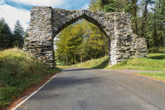 The Jubilee Arch, old graceful stone archway over minor road. Royalty Free Stock Photography