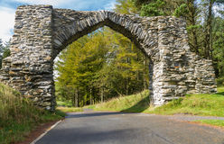 The Jubilee Arch, old graceful stone archway over minor road. Stock Photo
