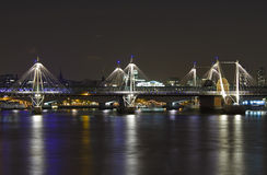 The Jubilee Bridge in London at night Stock Photo