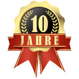 Jubilee button with banner and ribbons for 10 years. (in german stock image