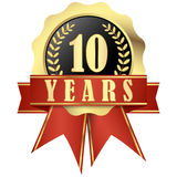 Jubilee button with banner and ribbons for 10 years. Golden jubilee button with banner and ribbons for 10 years Royalty Free Stock Images