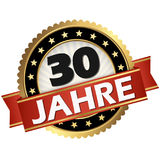 Jubilee button 30 years. Round jubilee button with red banner and german text 30 years Royalty Free Stock Image