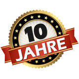 Jubilee button 10 years. Round jubilee button with red banner and german text 10 years Stock Illustration
