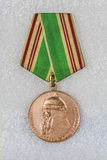 Jubilee medal in honor of the Soviet 800th anniversary of Moscow. Jubilee State Medal of the USSR after the 800th anniversary of the founding of Moscow Stock Photo