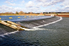 Jubilee River Weir Windsor England. Weir on the Jubilee River, a channel taking overflow from the River Thames to prevent  flooding to surrounding areas. Windsor Stock Photography