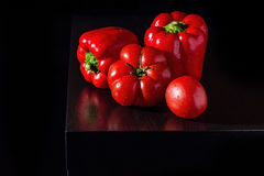 Jucy bell peppers and fresh tomatoes on dark wooden background Stock Photo