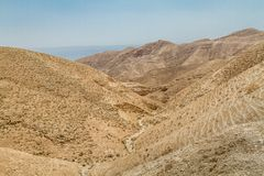 Judaean Desert in the Holy Land, Israel. Dry riverbed near the monastery of Saint George of Choziba in Judaean Desert in the Holy Land, Israel Stock Images