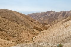 Judaean Desert in the Holy Land, Israel. Dry riverbed near the monastery of Saint George of Choziba in Judaean Desert in the Holy Land, Israel Royalty Free Stock Photos