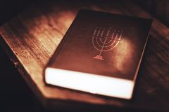 Judaic Torah Book. Torah Book Central Reference of the Religious Judaic Tradition. Menorah Symbol on the Book Cover Stock Photography