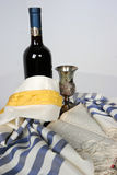 Judaica II. Scriptures opened with Talid resting on it Kaddish cup and a bottle of red wine Royalty Free Stock Photography
