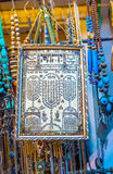 The Judaical pray. TEL AVIV, ISRAEL - FEBRUARY 25, 2016: The retro screen with Judaical pray, written in form of menorah in the flea market stall, on February 25 Royalty Free Stock Photo