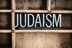 Judaism Concept Metal Letterpress Word in Drawer. The word JUDAISM written in vintage metal letterpress type in a wooden drawer with dividers Stock Image