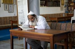 Judaism. Jewish orthodox man is reading hebrew text in the Abuhav synagogue in Safed, Israel. Since the 16th century, Safed has been considered one of Judaism's Stock Image