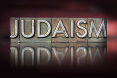 Judaism Letterpress. The word Judaism written in vintage letterpress type Stock Photos