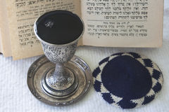 Judaism -  preparing for the Sabbath. Judaism - Sabbath Prayer with skullcap and wine Stock Photography