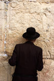 Judaism - Tisha B'Av. JERUSLAME -JULY 20:Orthodox Jewish man is praying גורןמע Tisha B'Av at the western wall on July 20 2010 in the old city in Jerusalem Royalty Free Stock Images