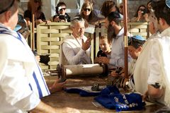Judaism. The Torah is showing during the bar-mitzvah celebration at the Western Wall in the Jerusalem old town, Jerusalem, Israel. Bar mitzvah is a Jewish coming Stock Photos