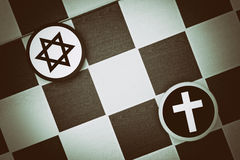 Judaism vs Christianity. Draughts (Checkers) - Judaism vs Christianity - religious tension and conflict between two monotheistic religions and believers, jews Stock Photo