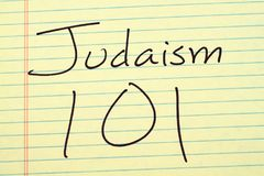 Judaism 101 On A Yellow Legal Pad. The words `Judaism 101` on a yellow legal pad Stock Image