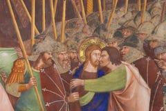 Fresco in San Gimignano - Kiss of Judas. Judas betrays Jesus with a kiss. 14th Century Fresco in the Collegiata of San Gimignano, Italy royalty free stock images