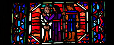 Judas kiss. Stained glass window depicting Jesus being betrayed by Judas with a kiss, in the Cathedral of Our Lady of Amiens, France Stock Images