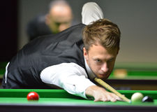 Judd Trump of England. Bangkok, Thailand - SEP 3:Judd Trump of England in action during Sangsom Six-red World Championship 2013 at Montien Riverside Hotel on royalty free stock photo