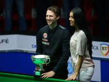 JUDD TRUMP. And his girlfriend poses with the trophy of the European Masters Snooker after a final played against Ronnie O'Sullivan ( not pictured ) in stock photos