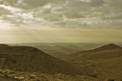Judean Desert and Dead Sea. Morning. Panorama of mountains in the distance and see the Dead Sea Stock Photography