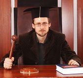 Judge. A man in spectacles and a gavel in his arm Stock Photography