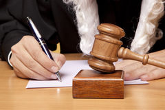 Judge. Referee hammer and a man in judicial robes Stock Image