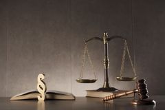 Law and justice symbols composition. Place for text. Judge antique gavel,scale, book and paragraph sign - law symbols on stone table and background Royalty Free Stock Photo