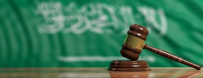 Judge or auction gavel on Saudi Arabia flag background. 3d illustration. Judge or auction gavel on Saudi Arabia waving flag background. 3d illustration Stock Images
