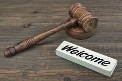 Judge Or Auctioneer Gavel And Sign Welcome On Wood Background stock photo
