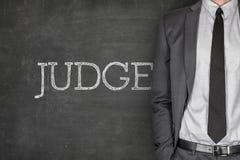 Judge on blackboard Stock Images