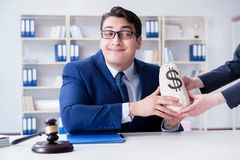 The judge in bribe concept with money. Judge in bribe concept with money Stock Photos