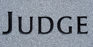 Judge carved in stone Royalty Free Stock Image