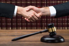Judge And Client Shaking Hands At Courtroom Royalty Free Stock Photography