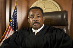 Judge .In Courtroom. Portrait of a male judge sitting in courtroom stock photography