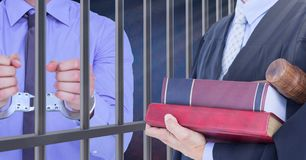 Judge and criminal in front of prison cell bars royalty free stock photos