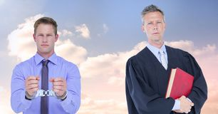 Judge and criminal in front of sky clouds Royalty Free Stock Images