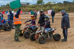The judge explains the rules. SERPUKHOV, RUSSIA - OCTOBER 7, 2017: Juniors before start,  Class ATV-JUNIORS, in the 4 stage  MX series, the Red Wings Cup 2017 Royalty Free Stock Photos