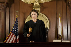 Judge Forming A Judgment Royalty Free Stock Photos