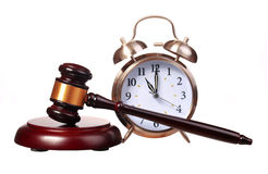 Judge gavel and Alarm Clock isolated on white Royalty Free Stock Photography