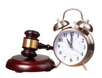 Judge gavel and Alarm Clock isolated on white Royalty Free Stock Photo