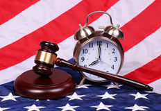 Judge Gavel and Alarm Clock over American Flag Stock Photos