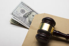 Judge gavel and american dollars on white background royalty free stock photos