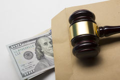 Judge gavel and american dollars on white background Stock Images