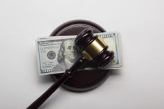 Judge gavel and american dollars on white background Royalty Free Stock Photography