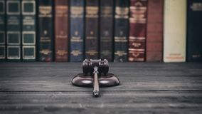 Judge Gavel on a black wooden background in front of a law library Royalty Free Stock Photography